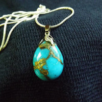 Copper Turquoise Natural stone pear shape Sky blue charm pendant, with silver plated bell cup and with a silver plated snake chain necklace.