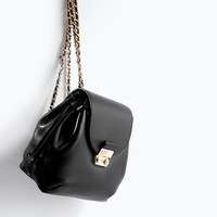 Leather backpack with metal clasp