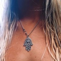 Hamsa Hand Pendent Necklace from Now and Again Co.