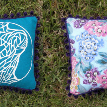 """Upcycled Teal Tshirt """"Body Project"""" Pillow with Floral Back and Dark Purple Pom Poms"""
