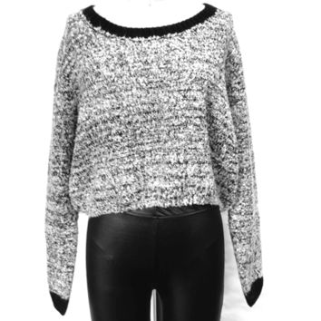Featuring super soft thick knit, black color ribbed round neckline, cropped construction, black color ribbed full length sleeves. Pair with high waist jeans and boots.