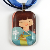 Glass Tile Pendant with Oriental Design on a Blue Organza Necklace