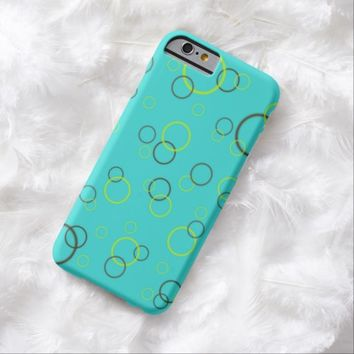 Lime and brown rings on turquoise iPhone 6 case