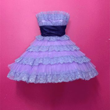 Super cute vintage Evening Tea Party Dress by Betsey Johnson (Early 2008 Collection). Featuring rows of fluffy mesh lace, authentic tea party evening dress, it has a dark Purple cinched waist sash ribbon tie in bow, mesh crinoline under plus attached Slip,