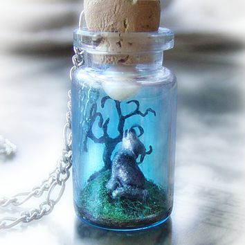 Wolf howling into the moon, bottle scene necklace