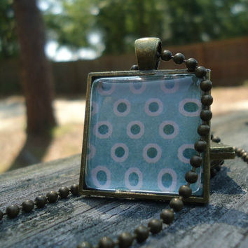 Green Dots: A pendant charm necklace made from a glass tile and a square pendant tray