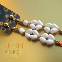 Neon touch. Long earrings with white drop shaped Czech glass beads and vibrant orange neon fringe. Neon jewelry.