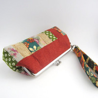 Wristlet frame clutch- stripe patchwork- dark orange