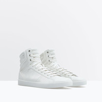 All white high-tops