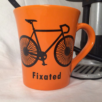 Funny orange fixated bicycle mug , Fixie bike mug