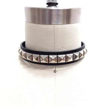 """Just Say Pyramid Studded Leather Choker is a pretty punk, super cool choker made from soft leather. Classic punk rock style piece that's about 0.8"""" wide, 24 pieces pyramid studded in a row design, and finish with adjustable snap button closured."""