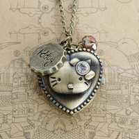 Pocket watch necklace of ancient bronze kitty design with round cap charm and crystal charm