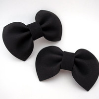 Set of two small black bows on barrette clips