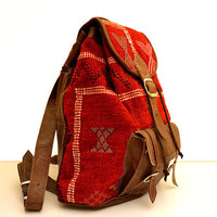 Brown Leather Backpack with a Unique Red Wool Touch