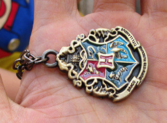 Harry Potter ravenclaw,  gryffindor,Slytherin  and hufflepuee House Crest Locket necklace------SALE