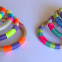 Leather bracelet wrapped in summer colour yarns