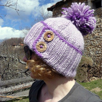 Women's knit hat in purple with pom pom