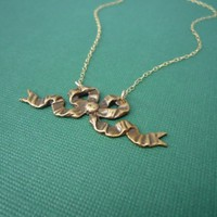 gold bitty bow necklace 14kt gold filled chain