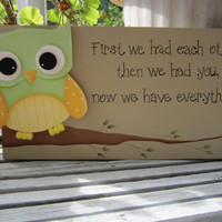 "Hand Painted Wooden Tan Sign, ""First we had each other, then we had you, now we have everything"". With a green and yellow owl."