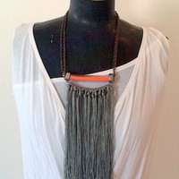 Yarn fringe and orange pvc necklace