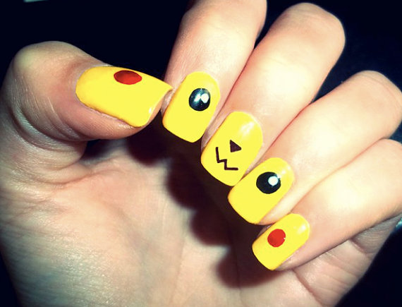 hand painted false nails with pikachu face on. vintage 90s kitsch indie pokemon japan