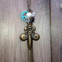 Gold color Fleur De Lis Cascading Charm Necklace