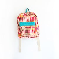 Orange and magenta abstract burlap backpack with turquoise pouch