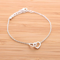 CROSSED HEART, never apart bracelet in silver