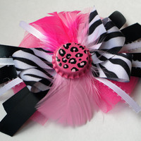 Pink, black and white zebra print hair bow with pink feather and bottle cap center