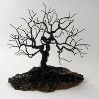 A twisted wire tree sculpture - Gnarly Tree on Bark.