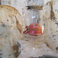 Glass bell jar with stand French chic ornate cloche display embellished with metal banner, rhinestone crown and trim anita spero