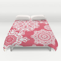 Flurries on Coral Duvet Cover by Lisa Argyropoulos