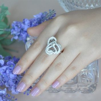 Magic Pieces Woman's Rhodium Plated Spinning Set: Cupid Hearts and Arrow Pendant and Triple Hearts Ring
