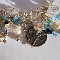 Astronomy bracelet, sterling silver with raygun, shuttle, telescope, NASA, comet, stars and more. Loaded with Swarovski