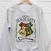 Hogwarts Alumni school Harry Potter sweatshirt cozy sweater for mens and womens heppy fit or sizing.