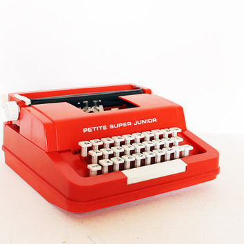 Vintage red typewriter by Byron Jardine Limited