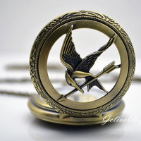 Hunger games pocket watch ,Antique Brass Mockingjay and Katniss arrow hunger games logo locket Pocket Watch Necklace Watch NWHG07