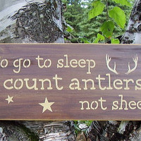 To go to sleep I count antlers, not sheep cabin sign
