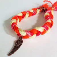 Orange, pink, and yellow braided friendship bracelet with wing charm, orange bracelet, braided bracelet, textile bracelet, angel wing charm,