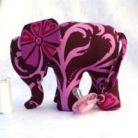 Elephant toy in pink and brown with pacifier tail and sound.