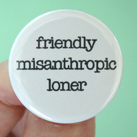 friendly misanthropic loner. 1.25 inch pinback button. Because hating others and being nice to them aren't mutually exclusive.