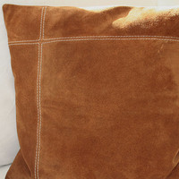 Pillow cover in suede with decorative stitchings