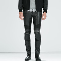 SYNTHETIC LEATHER TROUSERS WITH ZIPS Pictures