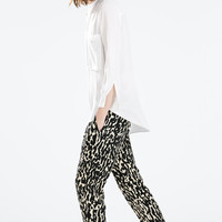 Animal print elasticated waist trousers