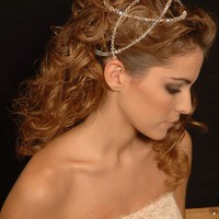 Romantically soft hairstyle with a headpiece and a Grecian feel