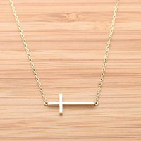 SIDEWAYS CROSS NECKLACE in gold by bythecoco on Zibbet