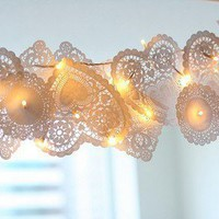 Lace doilies and fairy lights for Sansa or...