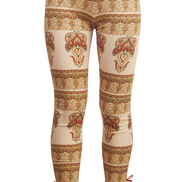 Leggings in stretch cotton jersey spandex in orange blossom signature print with button and bow details at cuff