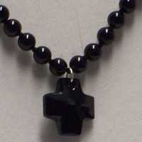 Knotted onyx and crystal cross necklace