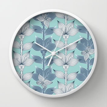 WHITE AND BLUE FLOWERS Wall Clock by Juliagrifol Designs